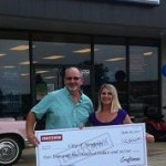 Sears gives a big check to Newport