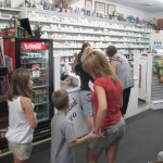 Folk line up to sign up at Mark's Pharmacy