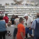 Folks gather around at Mark's Pharmacy