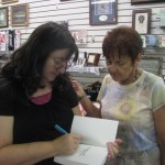 Laura Hilton, Author and Horseshoe Bend resident signs another copy of her new book