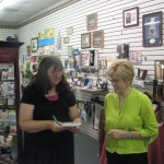 Laura Hilton, Author and Horseshoe Bend resident signs copies of her book