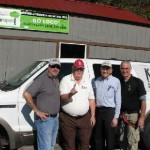 Bob Connell Rich Cahill and Fred Arnold with KFFB and Bob Cox with Loco Ropes talk time out for a picture