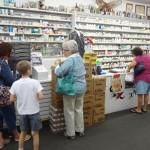 Folks line up to register at Mark's Pharmacy
