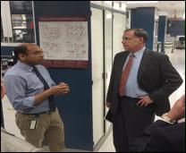 (Pictured: U.S. Senator John Boozman visits with Dr. Kartik Shankar, a researcher at ACNC.)
