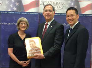 (Pictured: U.S. Senator John Boozman presents submissions for the Veterans History Project to Betsy Peterson, Director of the American Folklife Center and acting Librarian of Congress David Mao.)