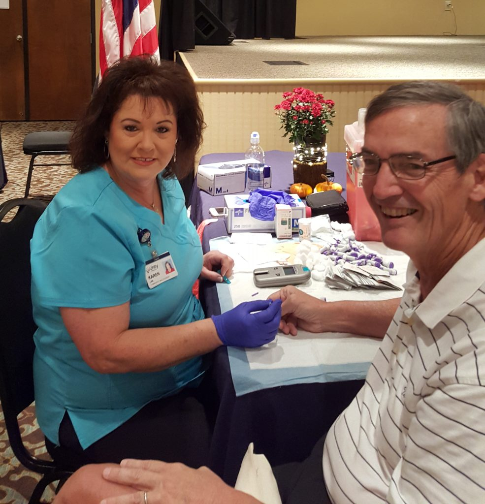Karen with Unity Health from Searcy test Mayor Paul Wellenberger