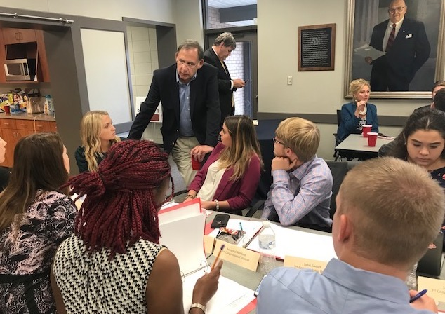(Pictured: U.S. Senator John Boozman visits with Congressional Youth Cabinet participants during the opening meeting at the Arkansas State Chamber of Commerce.)