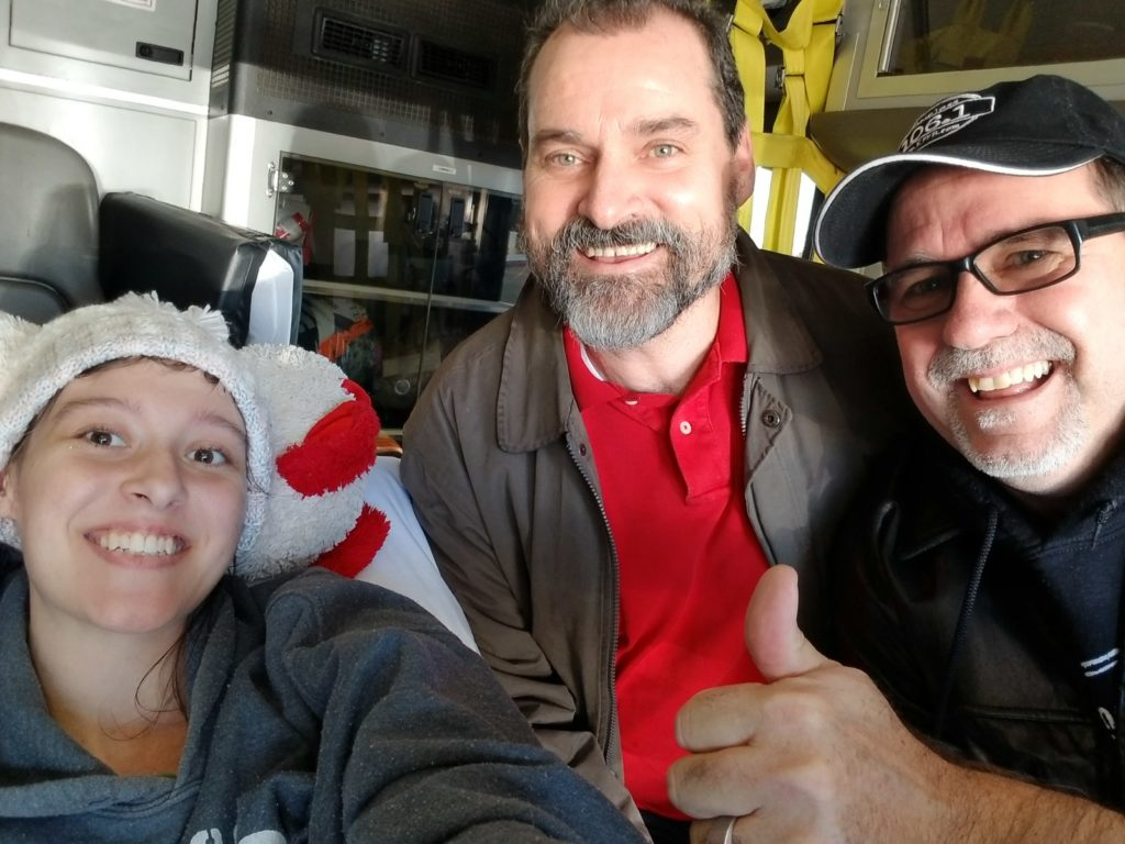 "Moriah""the Brave"" Moore, Earl Moore (Arrow's Cafe) and Bob Connell with Timeless 106.1 KFFB doing a live broadcast from the ambulance taking her home."
