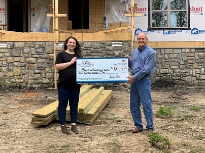 Habitat for Humanity Shannon Haney and First Community Bank's Tim Haunert